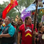 """'Save our planet!' Among the lead marchers was Rosebud Sioux Tribal Council President Cyril Scott, pictured here in the blue shirt. """"We're out here to save Mother Earth,"""" he told ICTMN. """"Save our planet. Get off your lazy butts and save our planet."""" (Photo: Steven Fontas/stevenfontas.com)"""